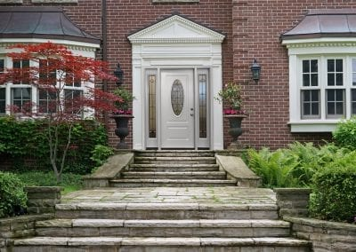 house front door with flagstone steps